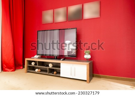 Red living room interior - stock photo