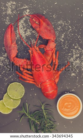 Red lobster on black trace, vintage, toning, aged - stock photo