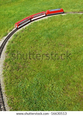 Red locomotive and passenger carriages - stock photo