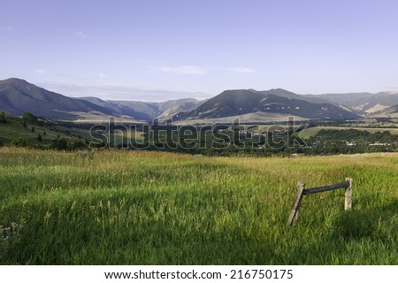 Red Lodge, Montana, USA - View from the Bear Tooth Pass Highway looking over the town of Red Lodge towards the Beartooth Mountains in Montana, USA.  - stock photo