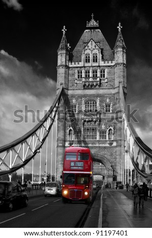 Red London Bus driving across Tower Bridge - stock photo
