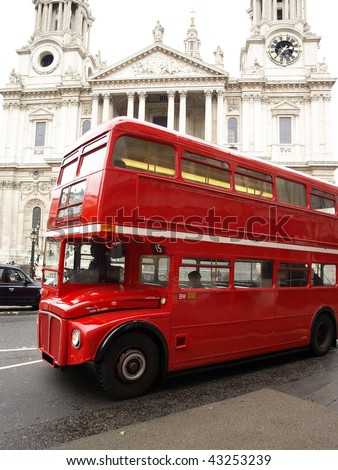 Red London Bus with St Paul's Cathedral in the Background - stock photo