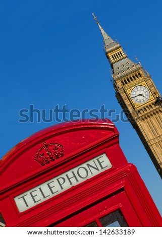 Red London phone box with Big Ben in the background. - stock photo