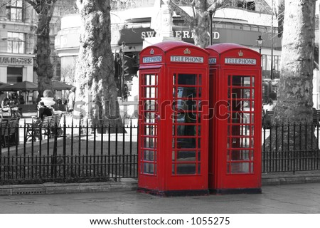 Red London telephone boxes at Leicester Square (on a B&W background) - stock photo