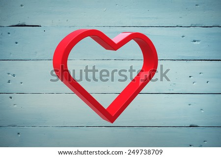Red love heart against painted blue wooden planks