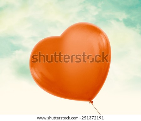 Red love heart balloon in vintage blue sky with clouds, clipping path and alpha channel included. - stock photo