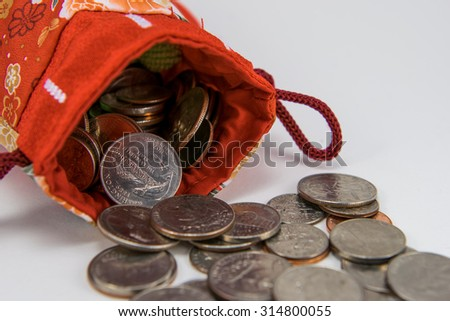 red lucky money bag with coins. - stock photo