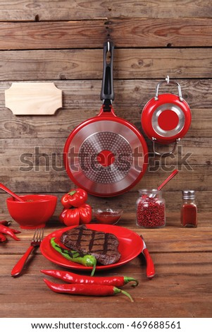 red lunch fresh grilled bbq roast beef steak red plate green chili tomato soup ketchup sauce paprika small glass ground pepper american peppercorn modern cutlery served wood table empty nameplate