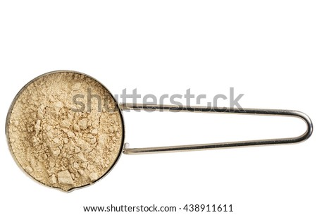 red maca root powder on a metal measuring scoop isolated on white - stock photo