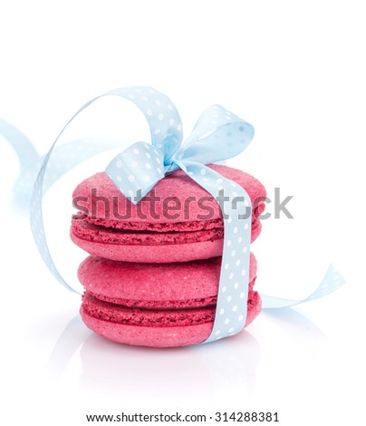 Red macarons with blue ribbon. Isolated on white background