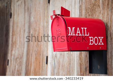 red mail box on wood texture - stock photo