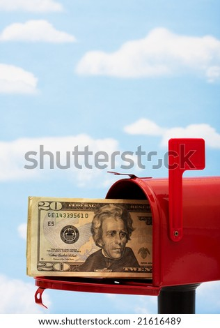 Red mailbox filled with twenty dollar bills and a blue sky and cloud background, mailbox - stock photo