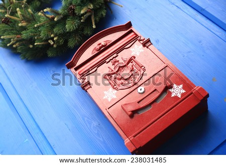 Red mailbox on the door for letters in Christmas - stock photo