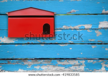 Red mailbox with blue wood background - stock photo