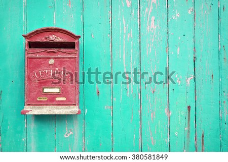 Red mailbox with green wood background - stock photo