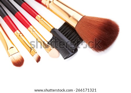 Red make up brushes isolated on white background