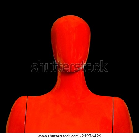 Red mannequin on black background