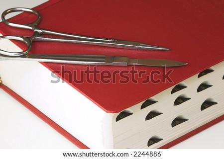 Red Manual with Hemostat and Scalpel - stock photo