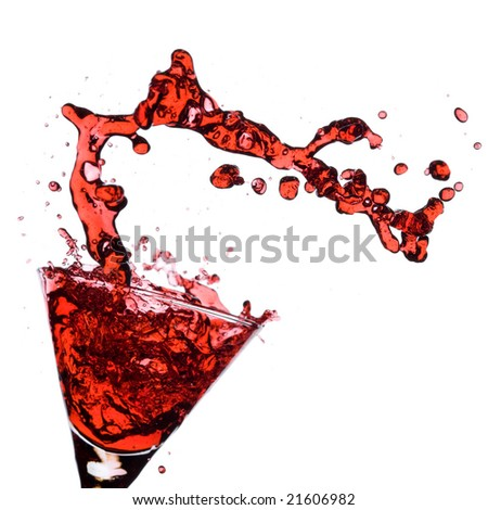 Red Martini being poured in a martini glass; isolated on a white background. - stock photo