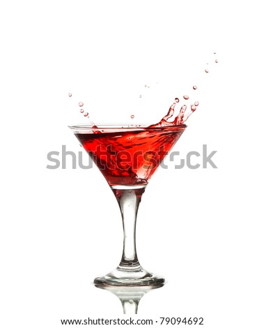red martini cocktail splashing into glass isolated on white background