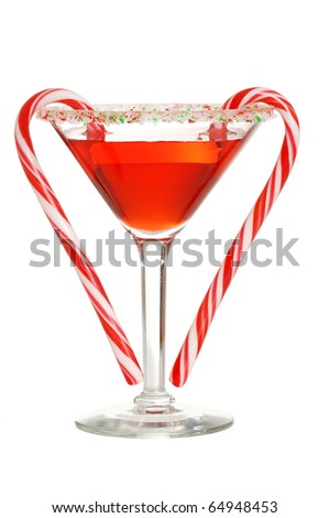 red martini with two candy canes - stock photo