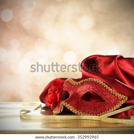 red mask and golden ribbon  - stock photo