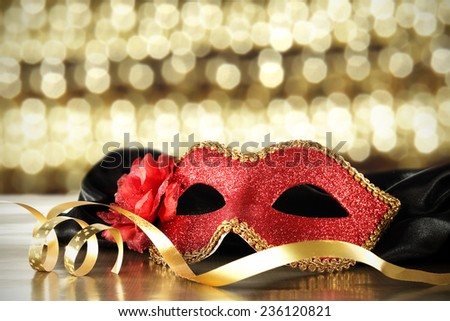 red mask and ribbon  - stock photo