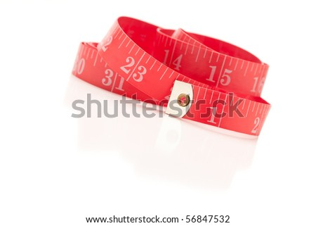 Red Measuring Tape Isolated on a White Reflective Surface.
