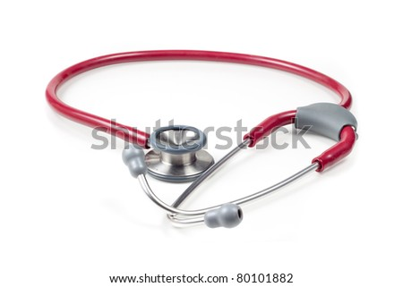 Red medical stethoscope on a white background