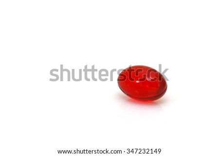 Red medicinal pill on white isolated background - stock photo