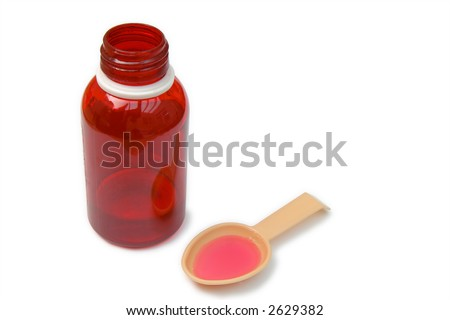 Red Medicine bottle and spoon - stock photo
