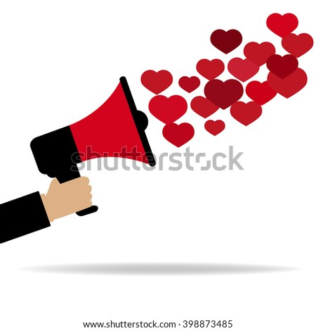 Red megaphone  from which fly out of the heart - stock photo