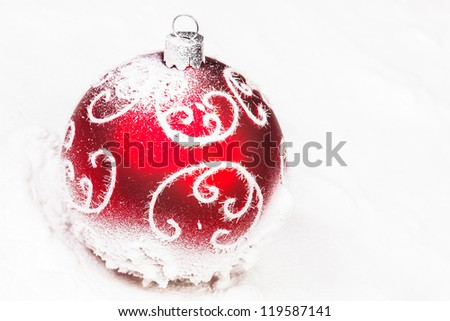 Red Merry Christmas bauble with snow