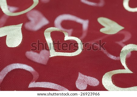 Red mesh Netting with golden heart pattern - stock photo