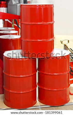 Red metal barrel drums for oil - stock photo