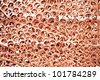 Red metal copper scrap materials recycling backround of punching waste - stock photo