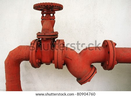 red metal pipe - stock photo