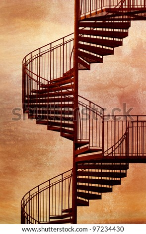 Red metal spiral staircase. - stock photo