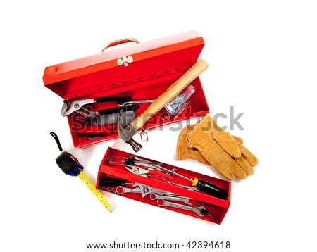 Red metal tool box with tools including hammer, tape measure, wrench, screwdriver and gloves on a white background - stock photo