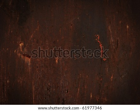 Red metallic surface with rust - stock photo
