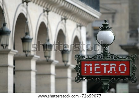 Red metro sign in Paris France - stock photo