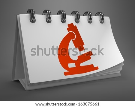 Red Microscope Icon on White Desktop Calendar Isolated on Gray Background. Science Concept. - stock photo
