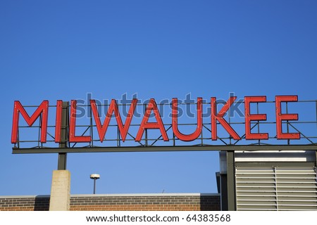 Red Milwaukee sign in downtown - stock photo