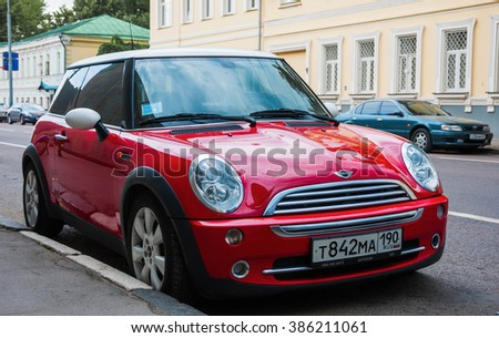 Red Mini Cooper parked at the roadside in Moscow. July 2011. Russia