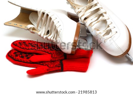 Red mittens and white skates - stock photo