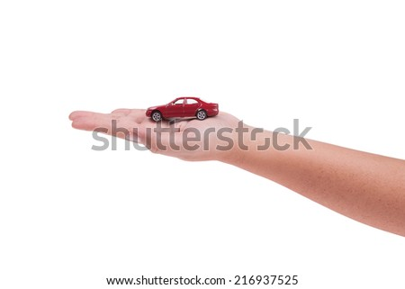Red model car on hand isolated on white background - stock photo