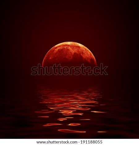 Red moon reflected in a wavy water surface - stock photo