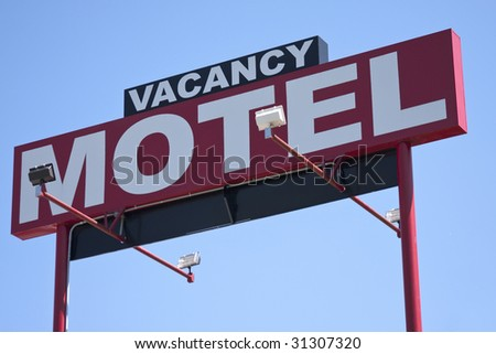 Red motel roadside sign with vacancy on top of it - stock photo