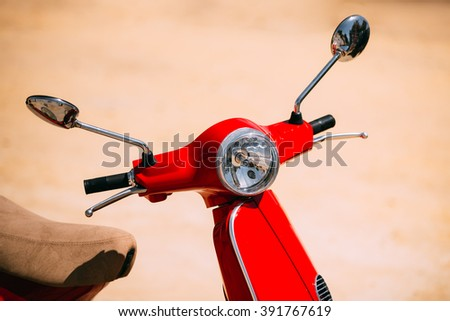 Red motorbike, motorcycle scooter parked in city. - stock photo
