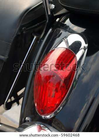 Red motorcycle stop-lantern. - stock photo